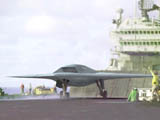 A Combat UAV takes off from a carrier.